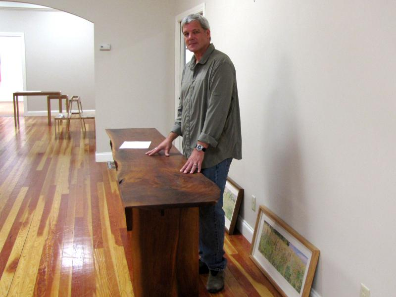 Dwayne Sperber in the Delafield Arts Center as the exhibit was being installed.