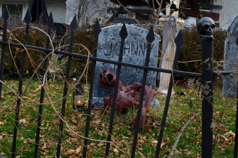 A gruesome gravesite sits on the front lawn of the Chens' home in Wauwatosa's Washington Highlands.