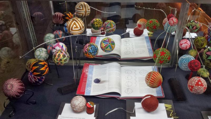 Silk-wrapped decorative balls called temari balls.