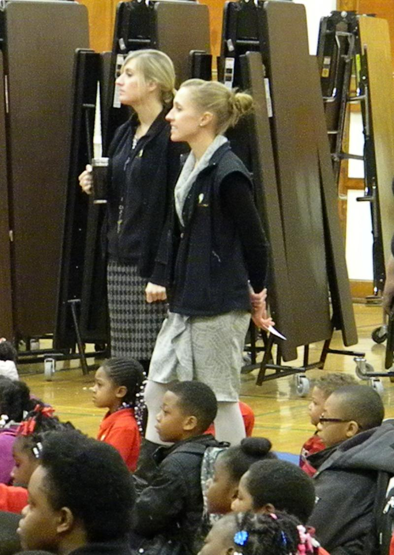 Lauren Boyd (center) attending a daily assembly with special education teacher Megan Miller (left) and the scholars.
