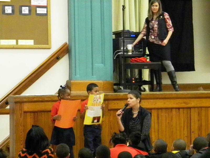 Principal Maggy Olson speaking with scholars at a daily assembly.