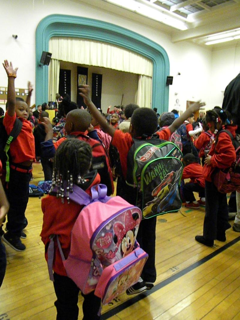 Scholars singing and dancing at the beginning of the school day.