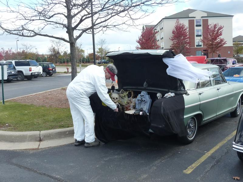"A ""mad scientist"" and his hot rod decorated for Halloween at the trunk-or-treat event at the car-themed restaurant Quaker Steak and Lube on Saturday, Oct. 26th in New Berlin"
