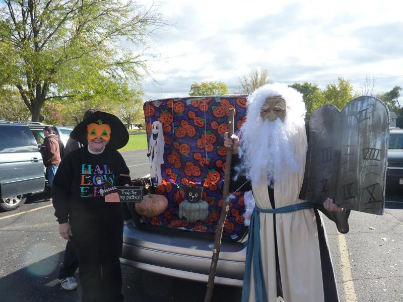 """Moses"" and another ""trunker"" hand out treats from the trunk of their car at the Messiah Evangelical Lutheran Church's 2nd annual trunk-or-treat event in Beloit, on Saturday, Oct. 26th."