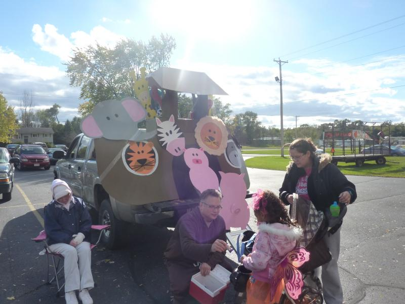 "Karl Wetzel of Orfordville hands out candy from his ""Noah's Ark"" themed car at the Messiah Evangelical Lutheran Church's 2nd annual trunk-or-treat event in Beloit, on Saturday, Oct. 26th."