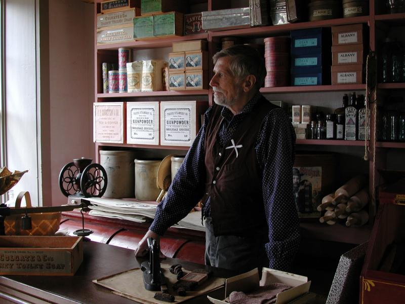 An interpreter dressed as a shopkeeper at Old World Wisconsin