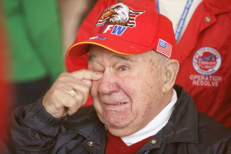 A veteran is overcome during a special Stars and Stripes Honor Flight program.