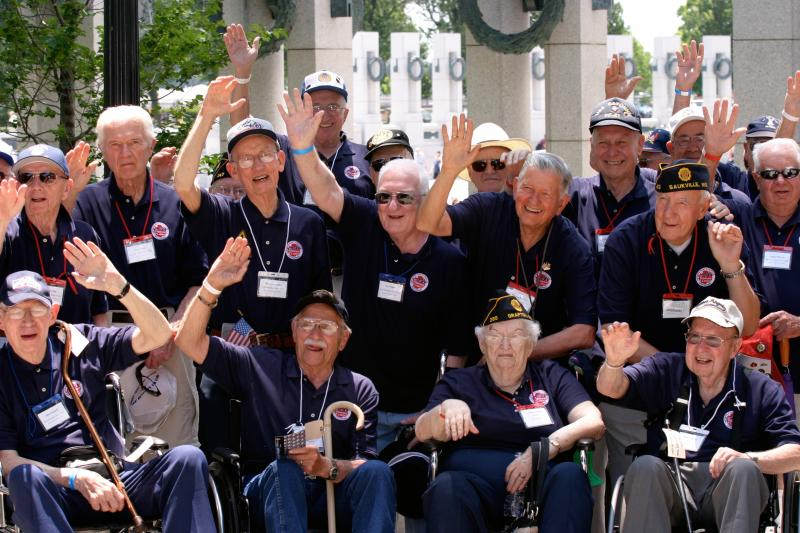 Veterans celebrate during their Stars and Stripes Honor Flight visit to Washington, D.C.