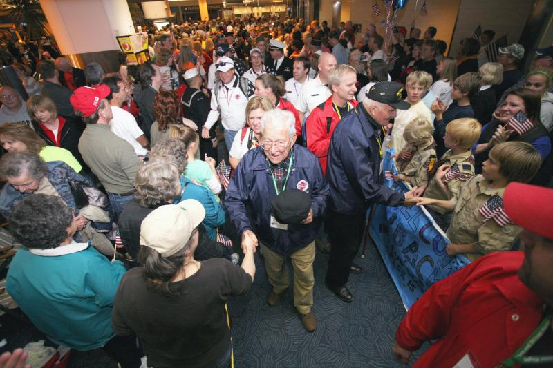 Veterans on their Stars and Stripes Honor Flight trip to Washington, D.C.  are greeted by crowds at the airport.