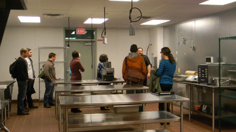Chef Adam Haen (second from right) talks with the aspiring food entrepreneurs who share space at FEED Kitchen.