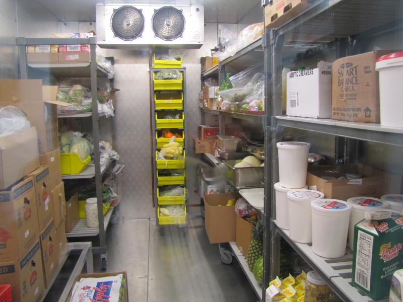 Kitchen features walk-in coolers - one for produce; the other, protein.