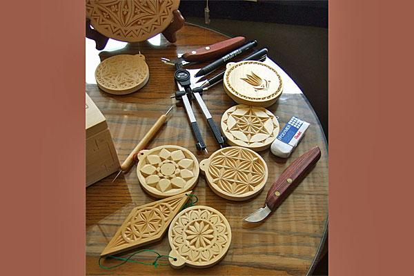 Chip carving (here by artist Ellen Macdonald) is a Norwegian tradition of wood-working.  It plays a big role in Ernst's novel.