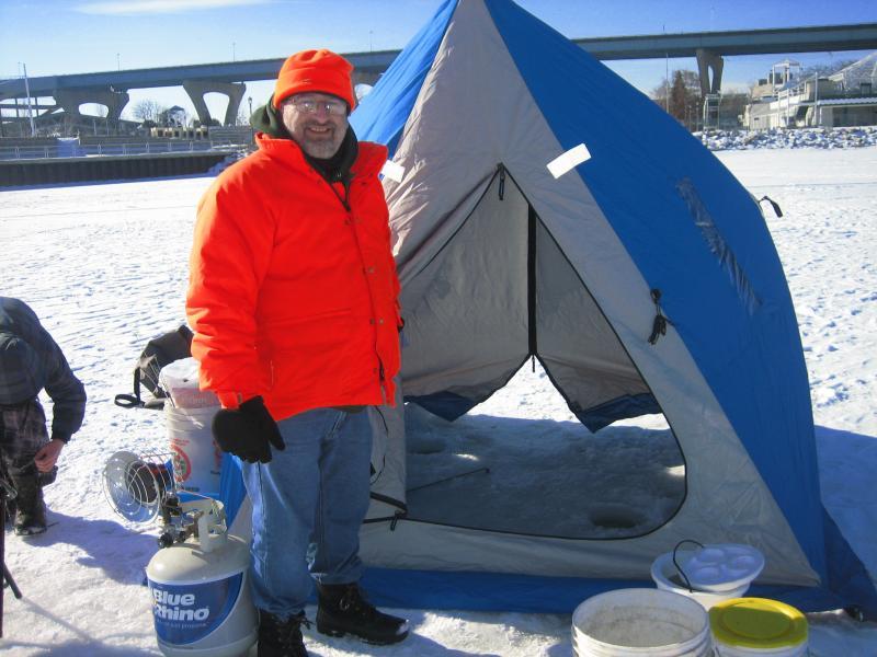 Robert Zalewski hauls in a warming tent.