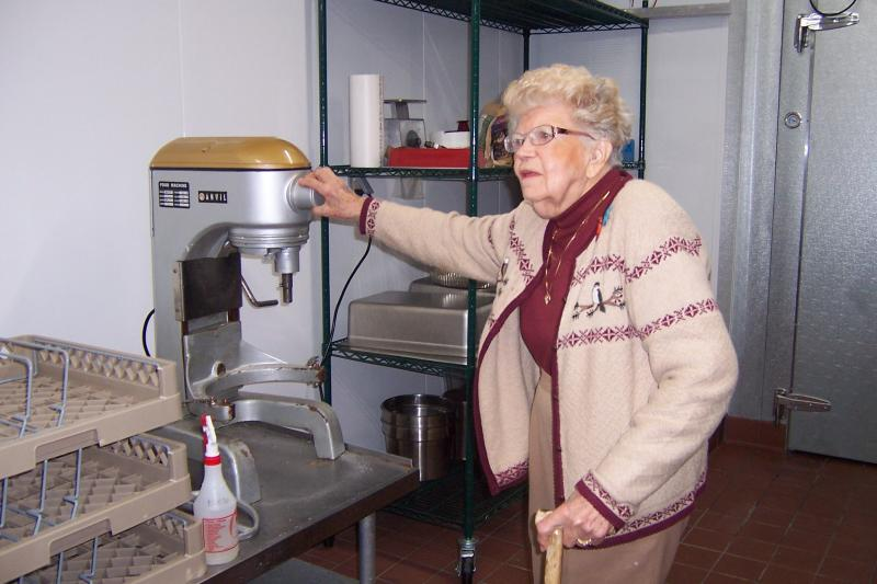 Betty Betenz looks over the machine used thr grind the hundreds of pounds of potatoes the restaurant goes through on a Friday evening.
