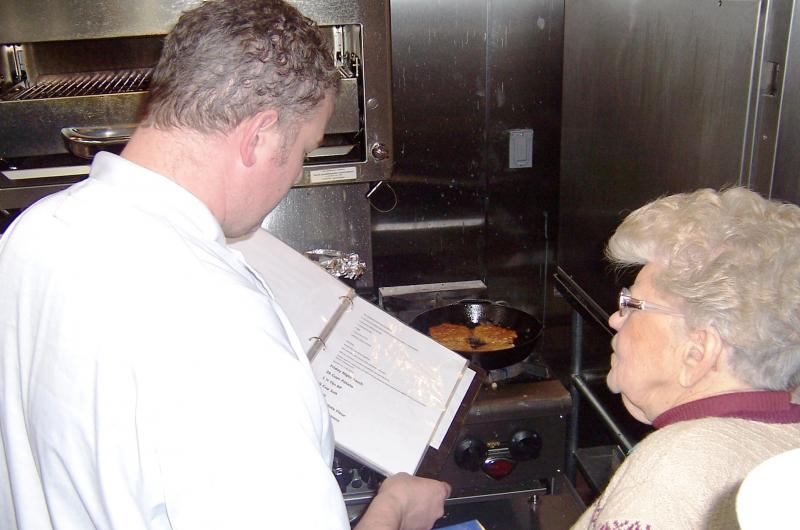 Nate Chappell and Betty Betenz go over the finer points of her potato pancake recipe, honed over seven decades.