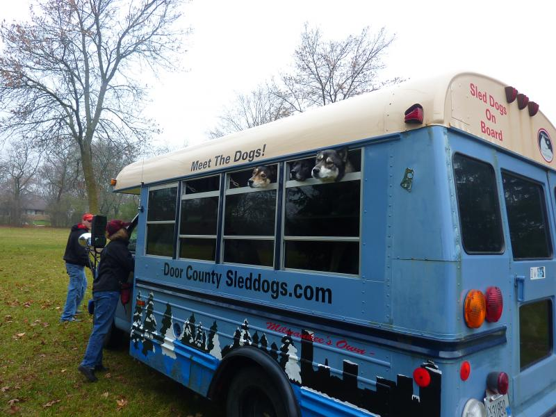 The Door County Sled Dogs arrive in a Milwaukee park via a specially equipped van.