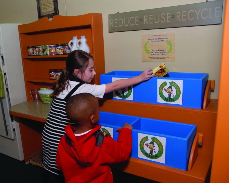 "Recycling at home at ""Smokey Bear and Woodsy Owl: Home Sweet Home"" at the Betty Brinn Children's Museum."