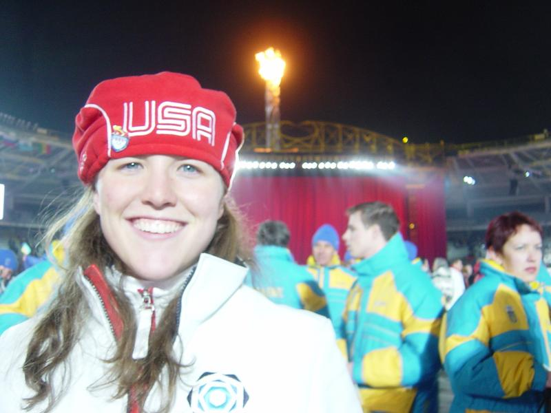 Carolyn (Treacy) Bramante pictured with the Olympic flame at the 2006 Winter Games in Torino.