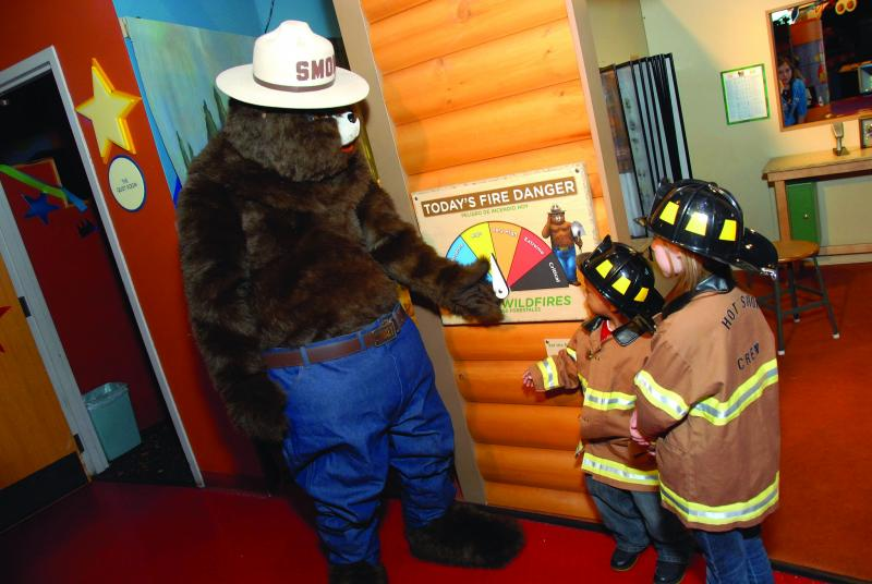 "Learning about today's fire danger at ""Smokey Bear and Woodsy Owl: Home Sweet Home"" at the Betty Brinn Children's Museum."