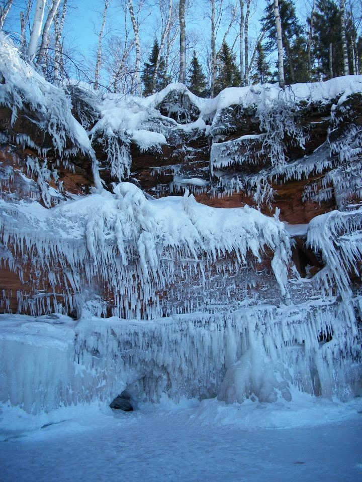 Water lapping at the sea caves freezes to create these ice sculptures.