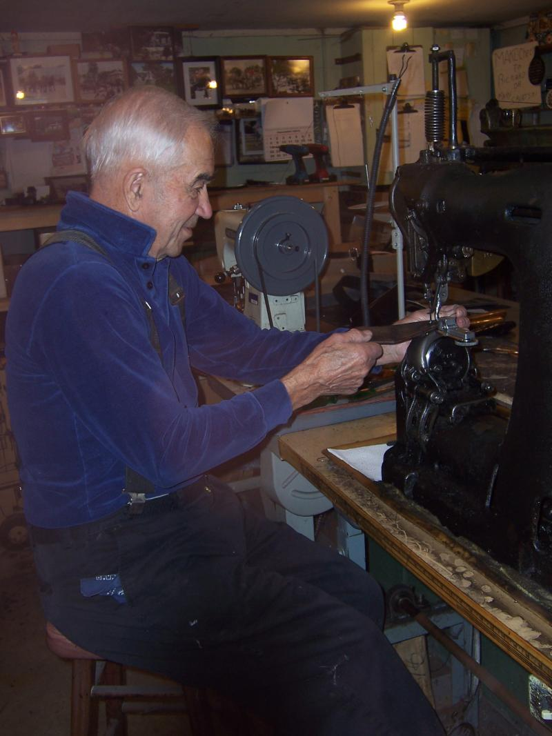 Harness maker Richard Savatski shows off his creasing machine in his Waterloo, Wis., workshop.