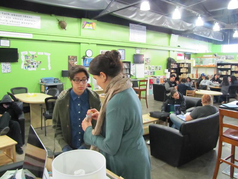 Student Andrea Alvarez talks with Advisor Kim Theisen on her chalk-making project.