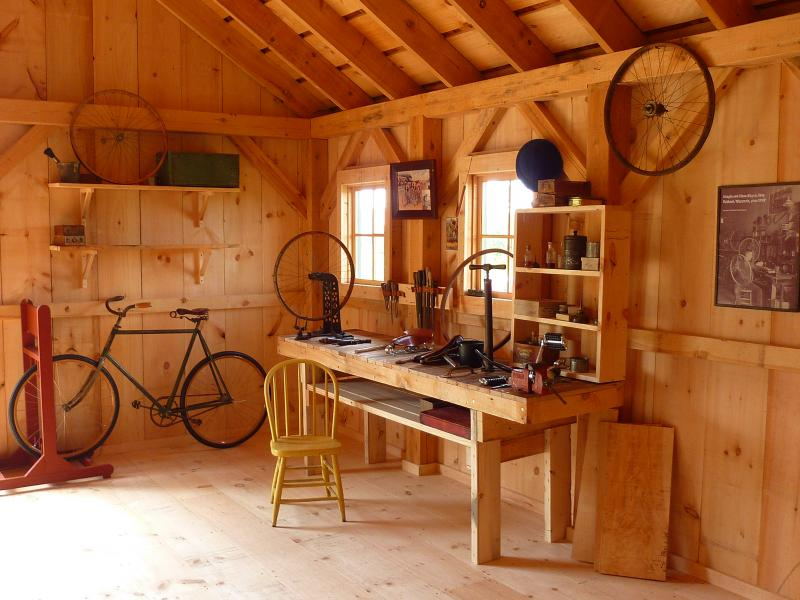 "A recreation bicycle shop, with an old-fashioned ""safety bicycle"" (on the left), lets visitors tinker with early bicycle technology."