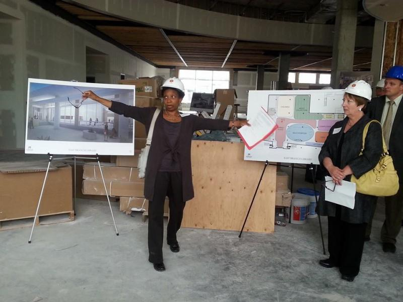 Deputy Library Director Joan Johnson explains what will be covered in the tour of the library.