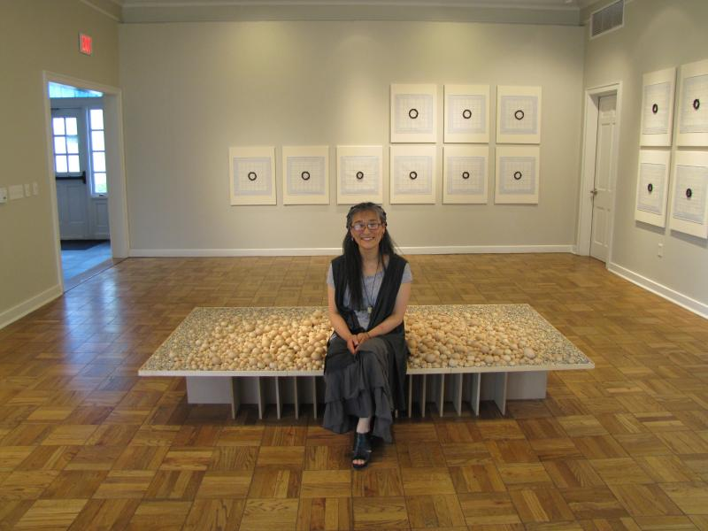 Cho sits on her piece titled Resonance