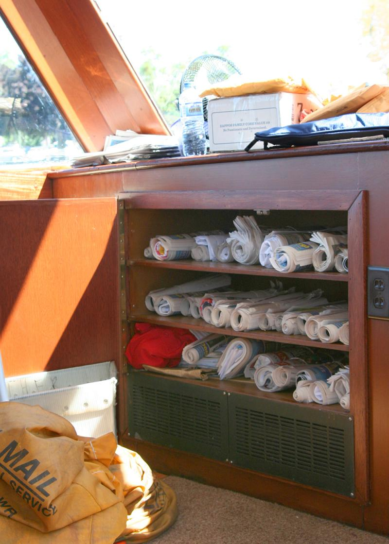 Mail jumpers roll up letters, magazines and newspapers, securing the bundle with rubber bands, to make the items easier to handle. The mail is stacked at the front of the boat in the order the Walworth will pass homes during the tour.