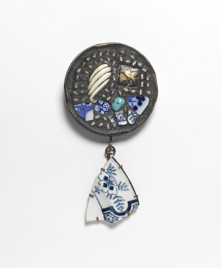 "Robert W. Ebendorf - ""Bring it Together,"" 2000. Found jar lid, glass, turquoise, china shards, ivory, copper, and tile grout 4 15/16 x 2 5/8 x 5/8 inches. Racine Art Museum, Promised Gift of The Porter•Price Collection"