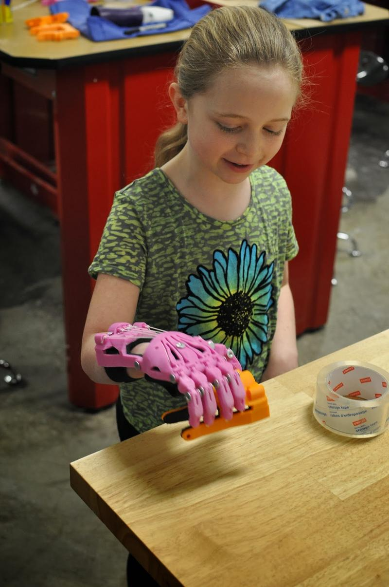 Shea tests her new hand at the UWM printing labs.