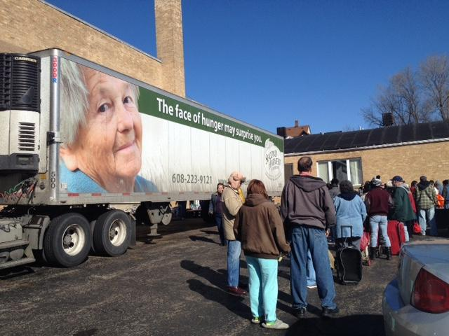 Perfect People Wait In Line In Beloit, Wisconsin To Enter A Mobile Food Pantry.
