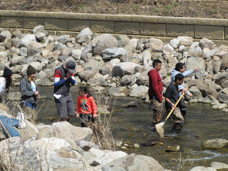 Volunteers cleaning up & exploring the KK River at 6th & Cleveland