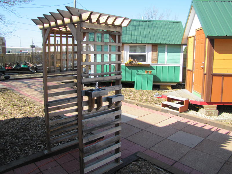 One of the tiny house resident built an arbor to welcome spring.