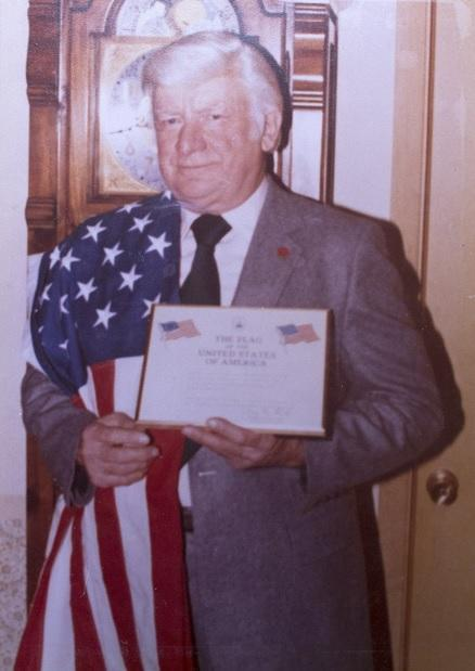 Albert Kosiek with a flag that had flown over the U.S. Capitol and was later used at his funeral.
