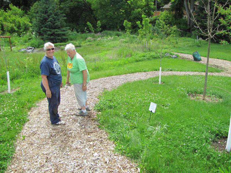 Sisters Mary Lou Schramer and Helene Mertes say Boy Scouts played a big role in creating the path that weaves through the urban forest toward what one day will be reflection area.