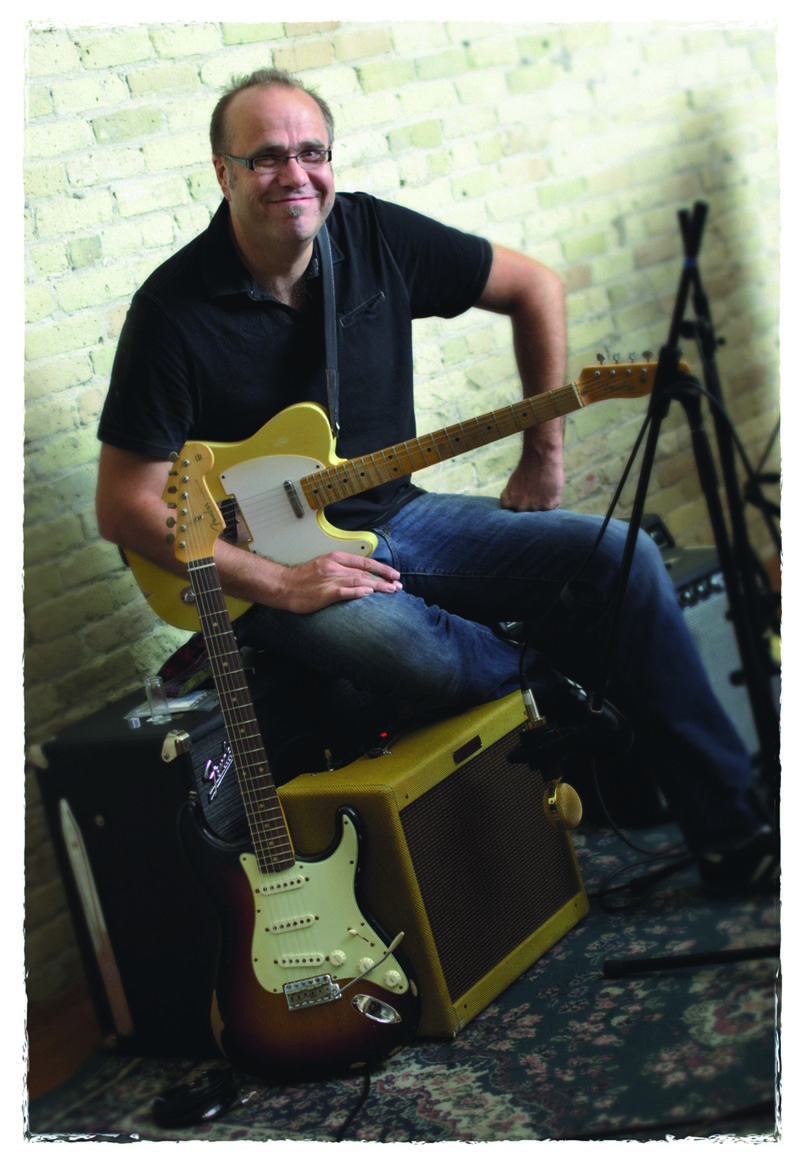 Greg Koch with Fender guitars and amplifier.