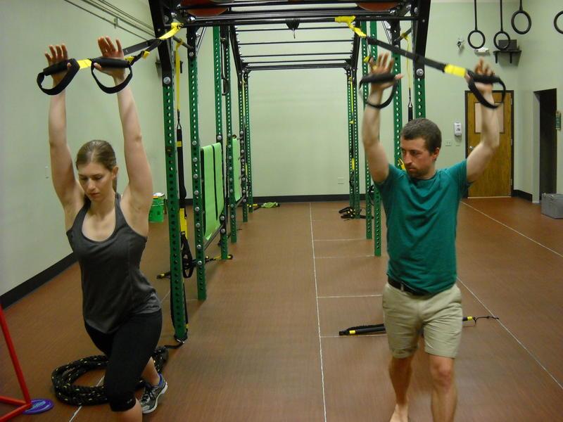 Dr. Dan Schumann demonstrates stretching utilizing TRX straps