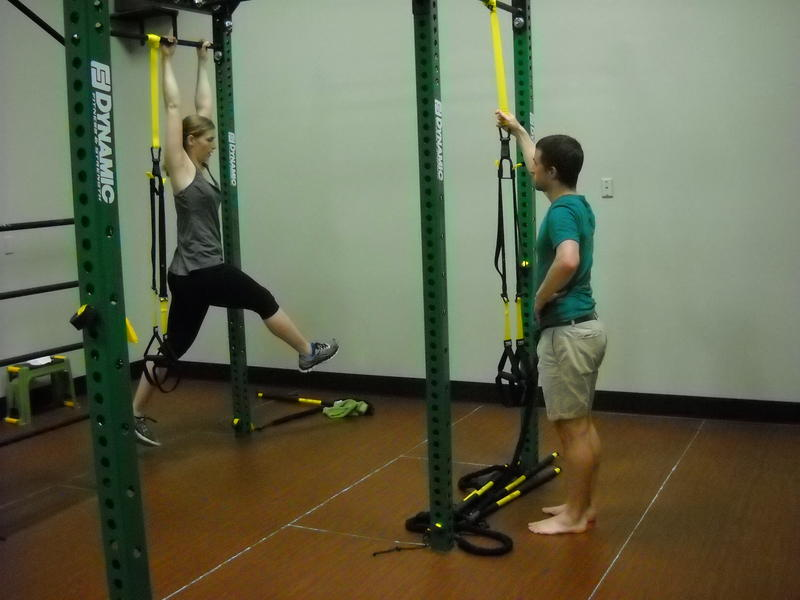 """Dr. Dan Schumann instructs Audrey Nowakowski through stretching, elongating, and strengthening the body on """"The Beast"""""""