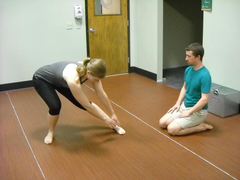Dr. Dan Schumann instructs Audrey Nowakowski through various 3D stretching techniques