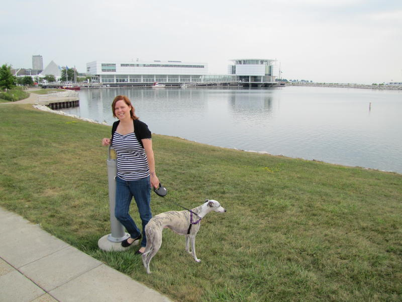 Event organizer Linda Reid and her dog Tadhg - Discovery World in the background.  That's where today's Lake Michigan Day is being held until 4 pm.