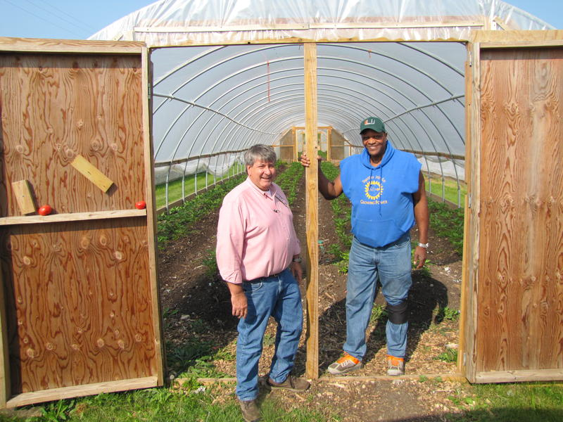 Sam Maglio and Growing Power's Will Allen outside one of 11 hoop houses adjacent to the Glendale plant.