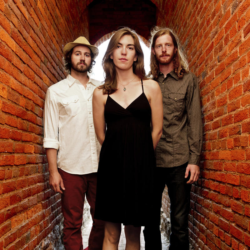 The Stray Birds, composed of multi-instrumentalists and vocalists Oliver Craven, Maya de Vitry, and Charlie Muench