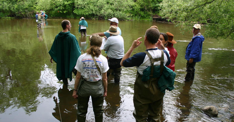 Citizen scientists monitor Milwaukee River Basin once a month.  Here they are in the Milwaukee River near Newburg.