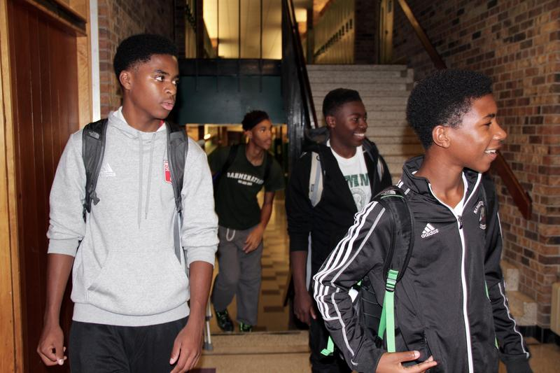 From left to right and back to front, Robert Bennett, Demitrius Kigeya, Odoi Lassey and William Lemkuil walk down the halls of Madison Memorial High School.