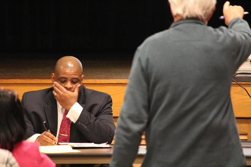 Dr. Demond Means took notes Thursday night as community members shared their thoughts on the program he now heads, the Opportunity Schools and Partnership Program.