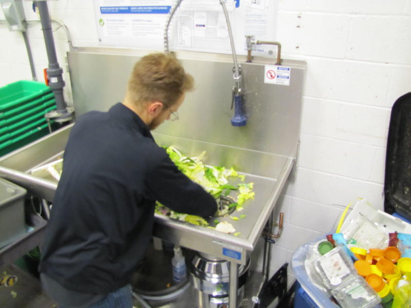 Jeff Schutte grinds up fruit and vegetable trimmings at Sendik's Food Market in Mequon.
