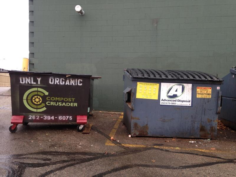 """A volunteer retrofited dumpsters to """"fit"""" Compost Crusader's garbage truck."""