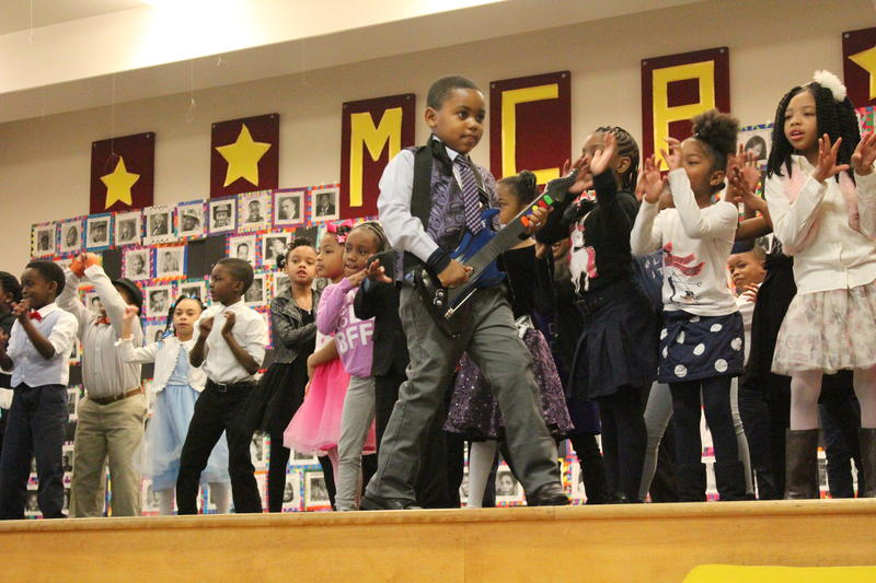 "First grade students rock out to ""Let's Go Crazy,"" honoring their chosen black icon, singer-songwriter Prince."